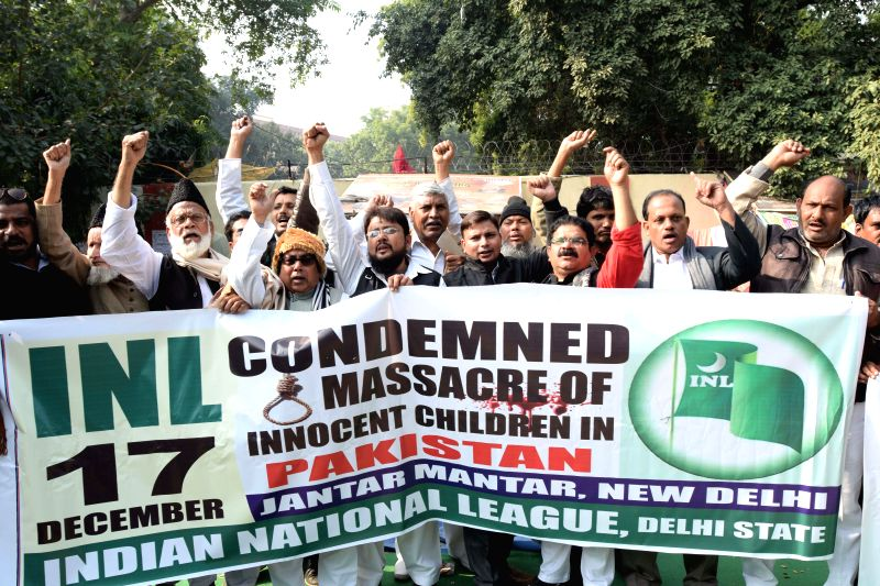 The members of Indian National League demonstrate to protest against Tuesday's attack on the Army Public School in Peshawar, Pakistan, that claimed 104 lives mostly those of children, at ..