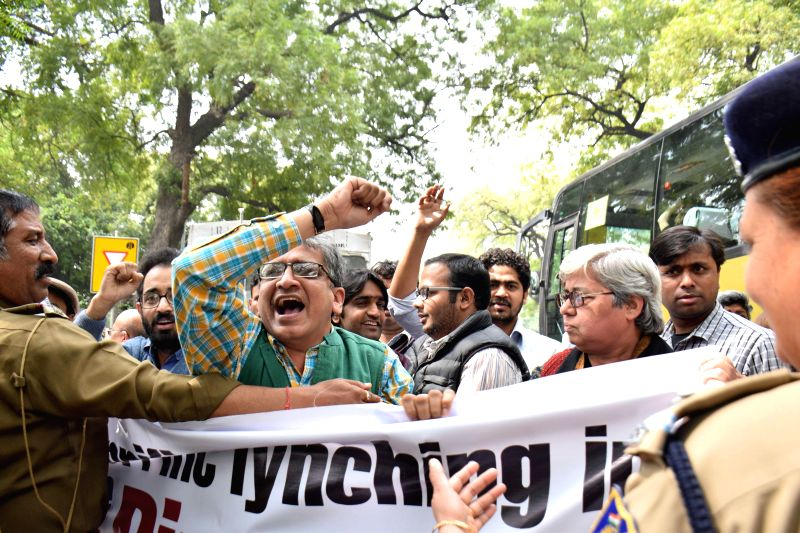 New Delhi:The members of Jamia Teachers' Solidarity Association stage a demonstration against lynching of an alleged rapist in Dimapur, in front of Nagaland House in New Delhi, on March 14, 2015.