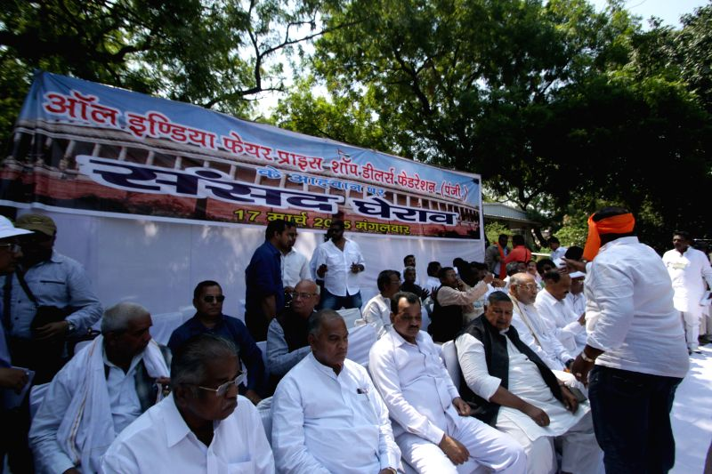 The members of the All India Fair Price Shop Dealers' Federation stage a demonstration at Jantar Mantar in New Delhi, on March 17, 2015.
