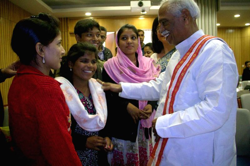 The Minister of State for Labour and Employment (Independent Charge), Bandaru Dattatreya meets children at the National Consultation on Child Domestic Work and Trafficking, in New Delhi on