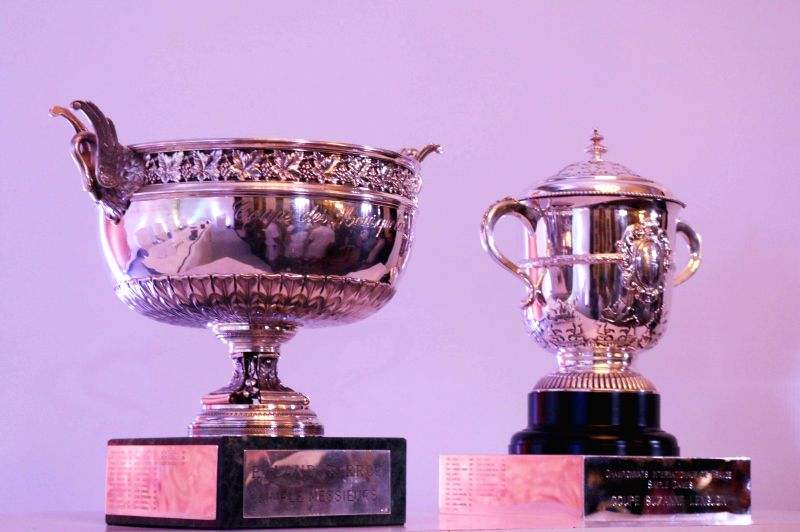 The Musketeer's Cup and the Suzanne Cup on display during a press conference regarding signing of a MoU between AITA and FFT (French tennis federation) in New Delhi, on March 31, 2015.