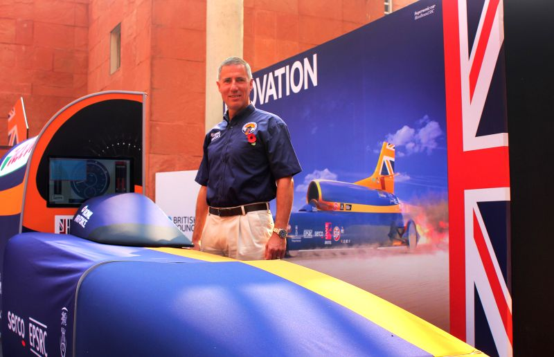 The pilot of BLOODHOUND SSC (supersonic car), Andy Green with the BLOODHOUND SSC  that was unveiled at the British Council in New Delhi, on Nov 11, 2014.