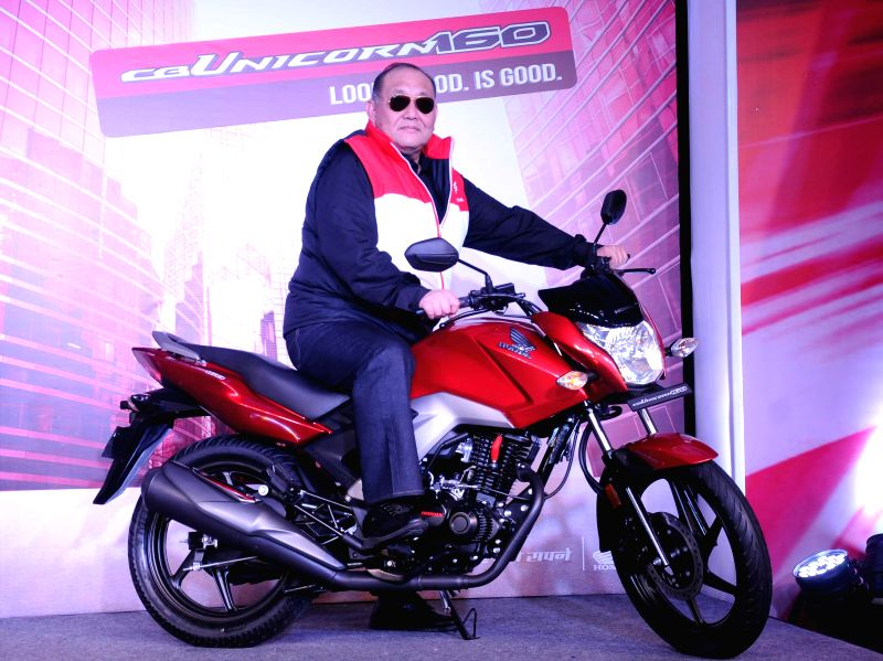 The President and CEO of Honda Motorcycle & Scooter India Pvt. Ltd. (HMSI) at the launch of Honda CB Unicorn 160 in New Delhi, on Dec 18, 2014.