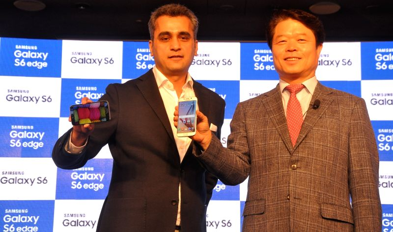 The President and CEO of  Samsung India Electronics HC Hong and the Vice President Samsung India (Marketing, Mobile & IT) Asim Warsi at the launch of GALAXY S6 and GALAXY S6 edge in ...