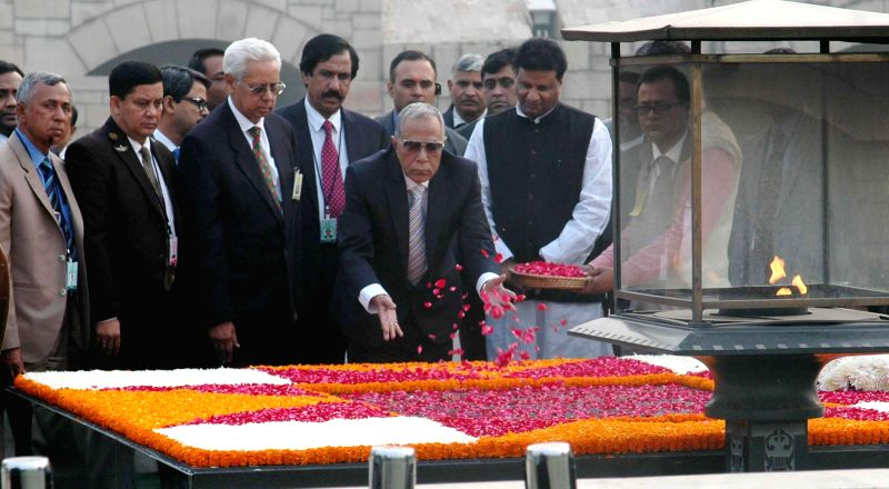 The President of the People`s Republic of Bangladesh Md. Abdul Hamid pays floral tribute at the Samadhi of Mahatma Gandhi, at Rajghat, in New Delhi on Dec 18, 2014.