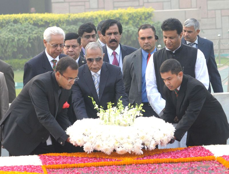 The President of the People's Republic of Bangladesh Md. Abdul Hamid pays floral tribute at the Samadhi of Mahatma Gandhi, at Rajghat, in Delhi on Dec 18, 2014.