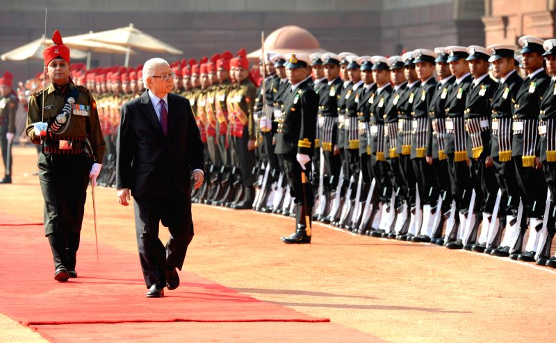 The President of the Republic of Singapore Dr. Tony Tan Keng Yam inspects guard of honour during a ceremonial reception organised for him at the Rashtrapati Bhavan, in New Delhi on Feb 9, .
