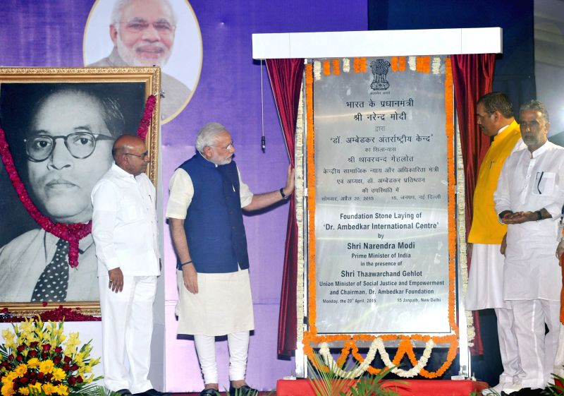 The Prime Minister Narendra Modi unveils the plaque to lay the foundation stone of the Foundation Stone laying Ceremony of Dr. Ambedkar International Centre, in New Delhi on April 20, ... - Narendra Modi