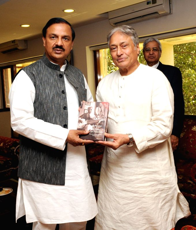The renowned Sarod player Amjad Ali Khan meets the Union Minister of State for Culture (Independent Charge), Tourism (Independent Charge) and Civil Aviation, Dr. Mahesh Sharma, in New ... - Mahesh Sharma