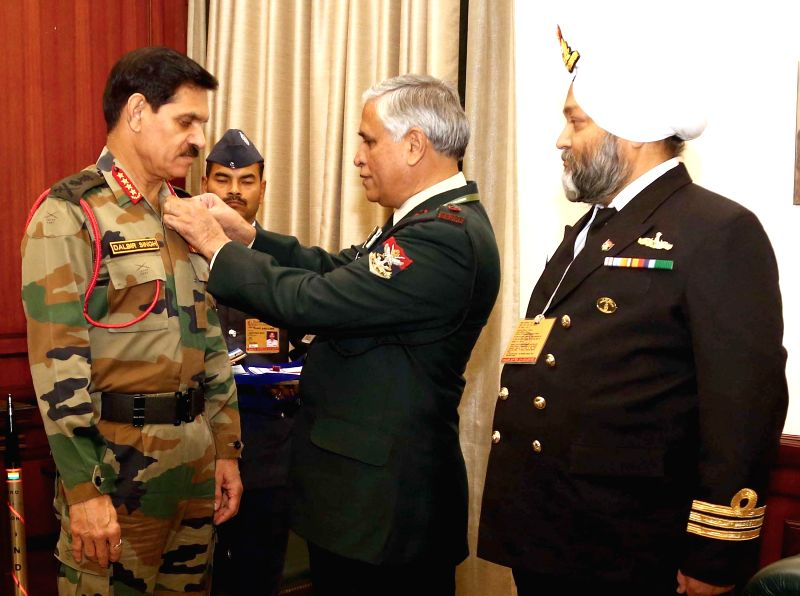 "The Service officers from Kendriya Sainik Board pin a lapel on the Chief of Army Staff, General Dalbir Singh on the eve of ""Armed Forces Flag Day"", in New Delhi on Dec 5, 2014. (Photo;"