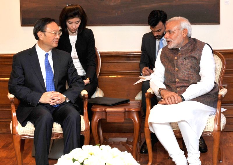 The State Councillor and Chinese Special Representative Yang Jiechi calls on Prime Minister Narendra Modi, in New Delhi on March 24, 2015. - Narendra Modi
