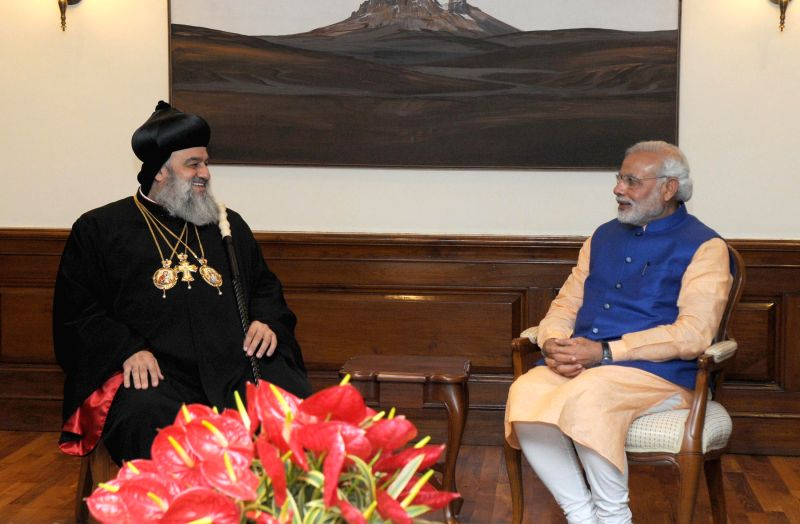 The Supreme Head of the Universal Syrian Orthodox Church H.H. Moran Mor Ignatius Aphrem II calls on Prime Minister Narendra Modi, in New Delhi on Feb 17, 2015. - Narendra Modi