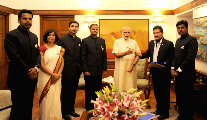 The team of First All India Services Expedition to Mt. Everest calls on Prime Minister Narendra Modi, in New Delhi on March 27, 2015. - Narendra Modi