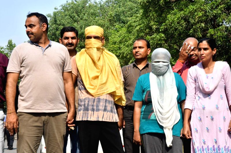 New Delhi: The two persons who have been arrested in connection with the murder of an elderly couple and their maid in Delhi's Vasant Vihar on June 26, 2019. Bodies of Vishnu Mathur, 78, Shashi Mathur, 75, and their maid Khushbu Nautiyal, 24, were fo