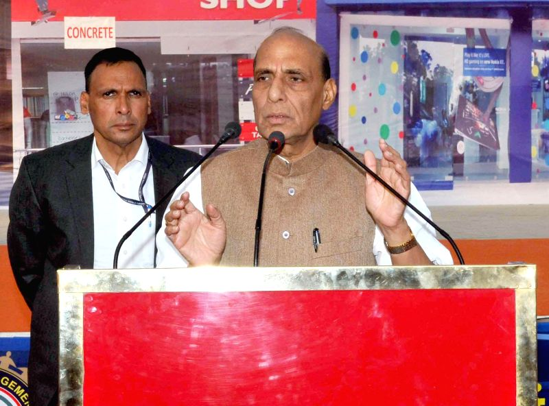 The Union Home Minister Rajnath Singh addresses during a demonstration of National Disaster Response Force (NDRF) at Pragati Maidan, in New Delhi on Nov 18, 2014.