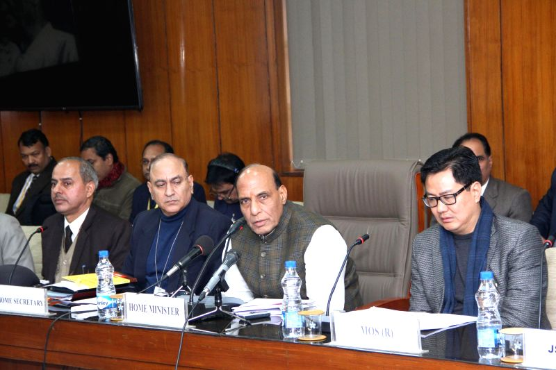 The Union Home Minister Rajnath Singh briefs media on the implementation of Bezbaruah Committee Report, in New Delhi on Jan 2, 2015. Also seen the Minister of State for Home Affairs Kiren .
