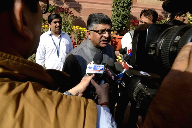 The Union Minister for Communications, and Information Technology, Ravi Shankar Prasad talks to press at the Parliament premises in New Delhi on Dec 4, 2014.