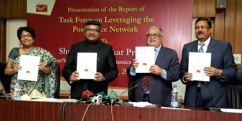 The Union Minister for Communications and Information Technology, Ravi Shankar Prasad releases a report on Leveraging the Post Office Network, in New Delhi on Dec 4, 2014.