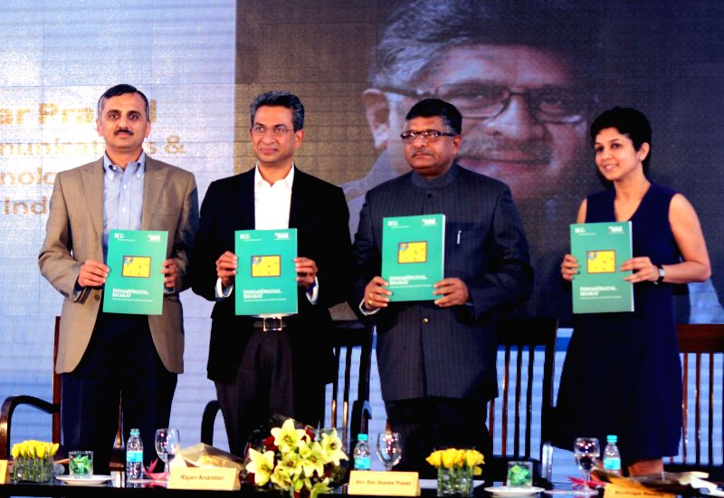 The Union Minister for Communications and Information Technology and BJP leader Ravi Shankar Prasad launches `INDIA @ DIGITAL BHARAT` - a book at the 9th Digital Summit 2015 organised by ..