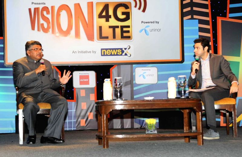 The Union Minister for Communications and Information Technology Ravi Shankar Prasad presides over a seminar on Vision 4G-India's next Telecom Revolution, in New Delhi on Feb 14, 2015.
