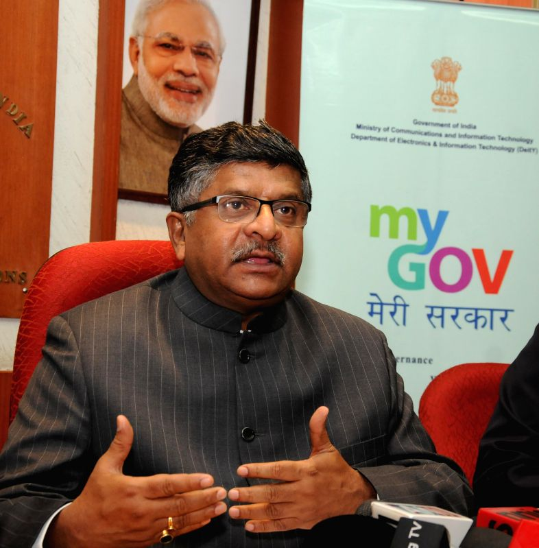 The Union Minister for Communications & Information Technology Ravi Shankar Prasad briefs the media at the launch of the `Contest for PMO Mobile App development`, in New Delhi on March ...