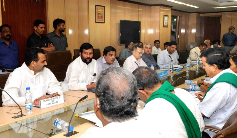 The Union Minister for Consumer Affairs, Food and Public Distribution, Ram Vilas Paswan during a meet with the representatives of farmers to discuss issue of sugarcane arrears, in New ... - Sanjeev Kumar Balyan and Distribution Sudhir Kumar
