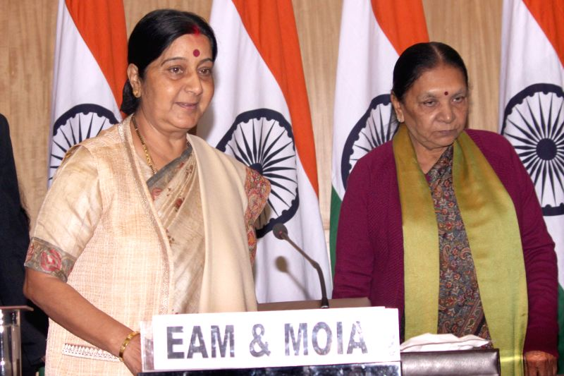 The Union Minister for External Affairs and Overseas Indian Affairs, Sushma Swaraj and Gujarat Chief Minister Anandiben Patel during a press conference regarding the forthcoming 13th ... - Anandiben Patel and Sushma Swaraj