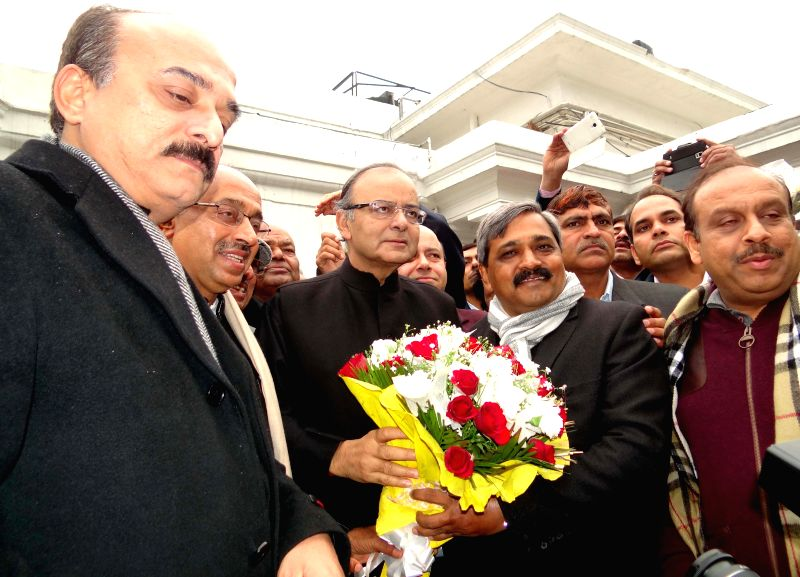 The Union Minister for Finance, Corporate Affairs, and Information and Broadcasting Arun Jaitley being greeted by Delhi BJP chief Satish Upadhyay during a programme in New Delhi, on Jan 2, - Satish Upadhyay