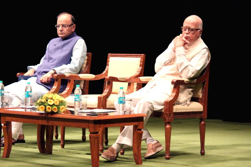 The Union Minister for Finance, Corporate Affairs and Information and Broadcasting Arun Jaitley and Senior BJP leader L K Advani during the BJP parliamentary party meeting at Parliament ... - Arun Jaitley and L K Advani