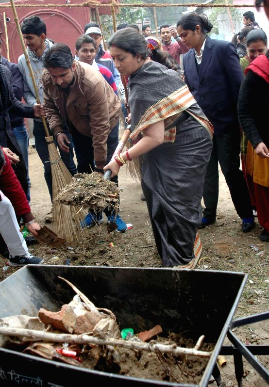 The Union Minister for Human Resource Development Smriti Irani participates in Clean India Campaign, at Sanjay Basti, Timarpur, in Delhi on Jan 8, 2015.