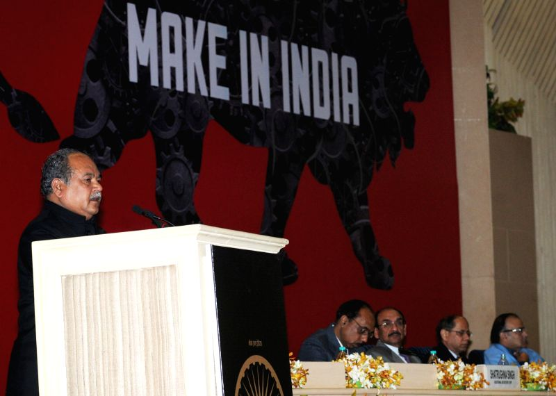 "The Union Minister for Mines and Steel Narendra Singh Tomar addresses at the National Workshop on ""Make in India"", in New Delhi on Dec 29, 2014."