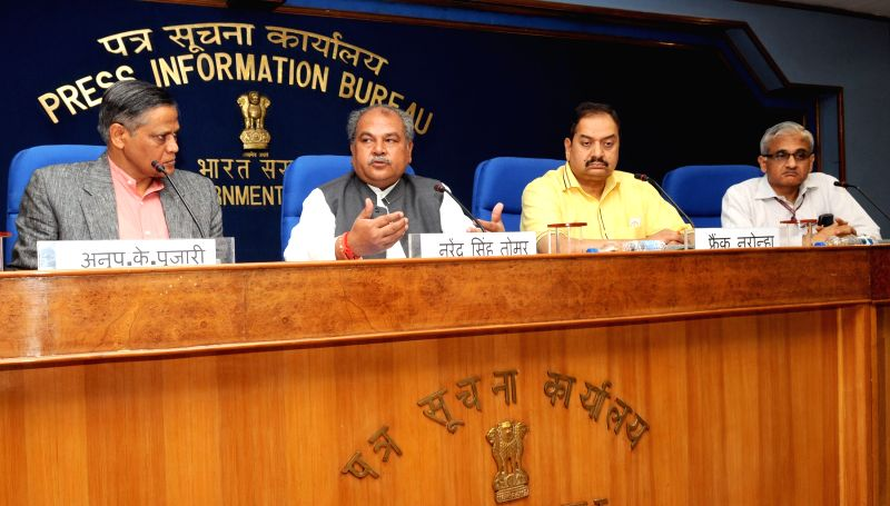 The Union Minister for Mines and Steel Narendra Singh Tomar addresses a press conference regarding the National Geoscience Awards 2013, in New Delhi on April 2, 2015. - Narendra Singh Tomar