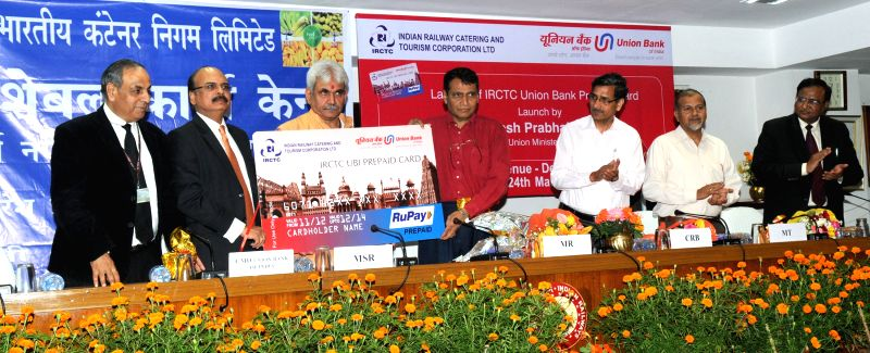 The Union Minister for Railways Suresh Prabhakar Prabhu launches the IRCTC Union Bank RuPay Prepaid card, at a function, in New Delhi on March 24, 2015. Also seen the Union Minister of ... - Suresh Prabhakar Prabhu and Manoj Sinha