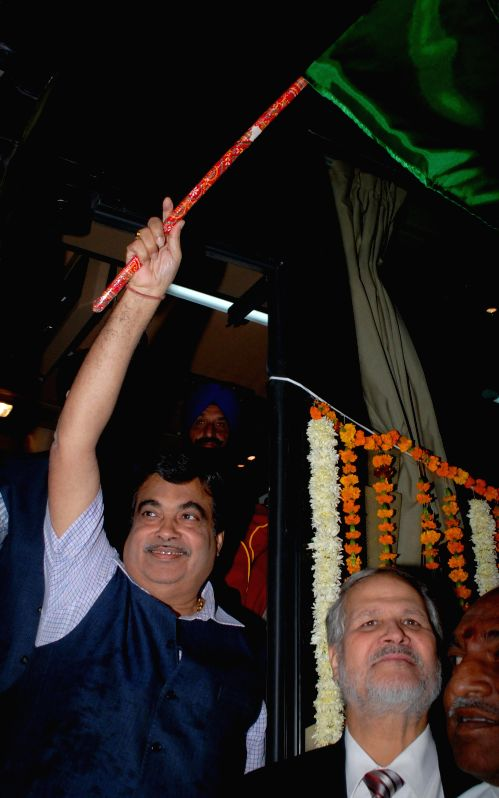 The Union Minister for Road Transport and Highways, and Shipping Nitin Gadkari and Delhi Lt. Governor of Delhi Najeeb Jung launch Indo-Nepal bus services in New Delhi on Nov 25, 2014.