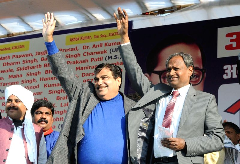 The Union Minister for Road Transport and Highways and Shipping, Nitin Gadkari with BJP MP Udit Raj during a rally organised to press for the Rights and Dignity of Dalits a at Ramlila ...