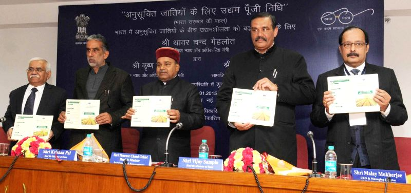 The Union Minister for Social Justice and Empowerment Thaawar Chand Gehlot releases the brochure of NSFDC at the launch of the Venture Capital Fund for Scheduled Castes, in New Delhi on ...