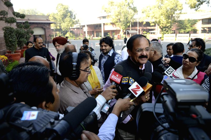 The Union Minister for Urban Development, Housing and Urban Poverty Alleviation and Parliamentary Affairs, M. Venkaiah Naidu talks to press at the Parliament premises in New Delhi on Dec .. - M. Venkaiah Naidu
