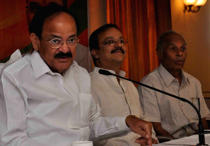The Union Minister for Urban Development, Housing and Urban Poverty Alleviation and Parliamentary Affairs M. Venkaiah Naidu addresses a Press Conference on Land Acquisition Bill, in ... - M. Venkaiah Naidu
