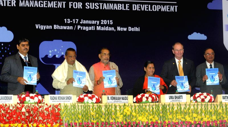 The Union Minister for Water Resources, River Development and Ganga Rejuvenation Uma Bharti releases a book at the inauguration of the India Water Week 2015, in New Delhi on Jan 13, 2015. . - Radha Mohan Singh