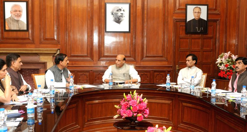 New Delhi The Union Minister of State for Culture (Independent Charge), Tourism (Independent Charge) and Civil Aviation, Dr. Mahesh Sharma during a meeting with Union Home Minister Rajnath Singh ... - Rajnath Singh