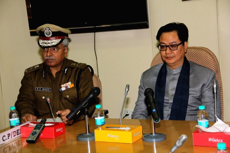 The Union Minister of State for Home Affairs Kiren Rijiju  during his visit to the Delhi Police Headquarters, in New Delhi on Dec 30, 2014. Also seen Delhi Police Commissioner B.S. Bassi.