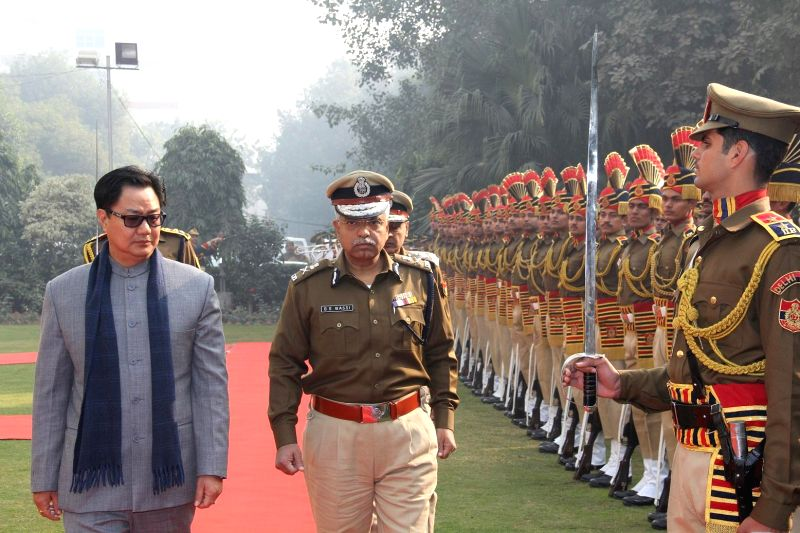The Union Minister of State for Home Affairs Kiren Rijiju inspects the guard of honour, during his visit to the Delhi Police Headquarters, in New Delhi on Dec 30, 2014. Also seen Delhi ...