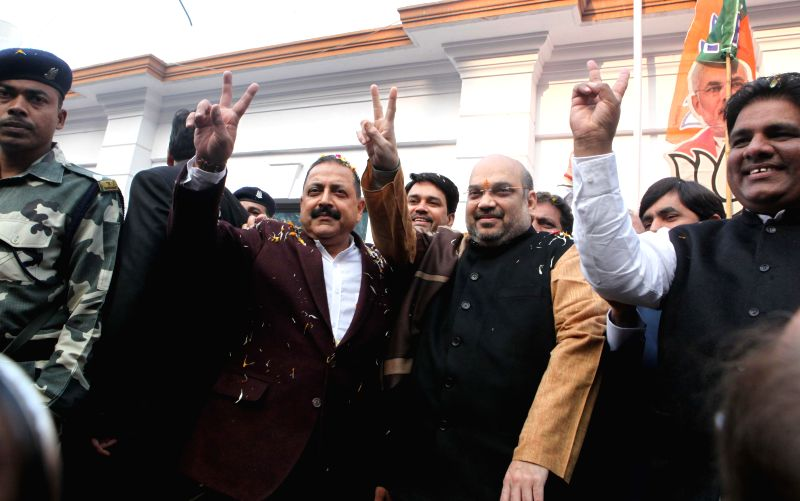 The Union Minister of State in the Prime Minister's Office and BJP leader Jitendra Singh with BJP chief Amit Shah celebrate party's performance in the recently held Jharkhand and Jammu and - Jitendra Singh