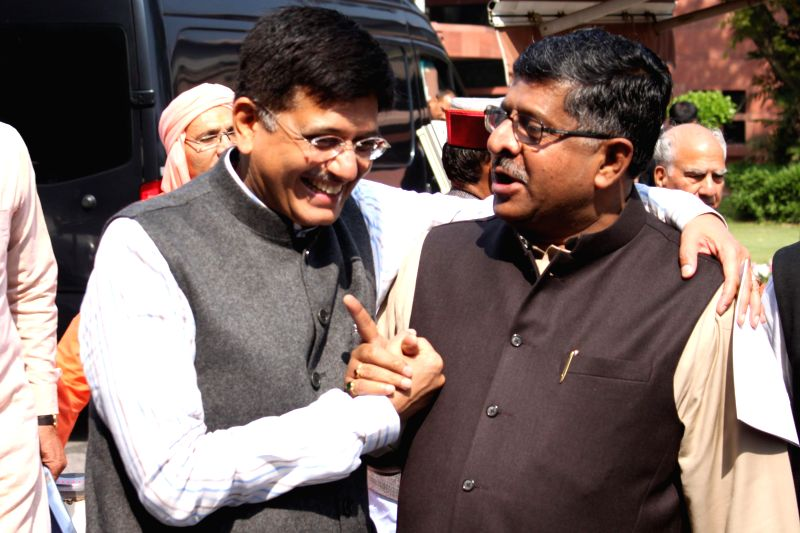 The Union Minister of State (Independent Charge) for Power, Coal and New and Renewable Energy Piyush Goyal and the Union Minister for Communications & Information Technology Ravi ...