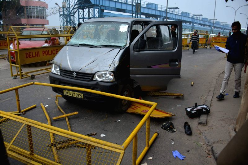 The vehicle that crushed two Delhi policemen at the site of the accident in south Delhi's Kalindi Kunj area on Dec 14, 2014. A Delhi Police assistant-sub inspector and a constable were ...