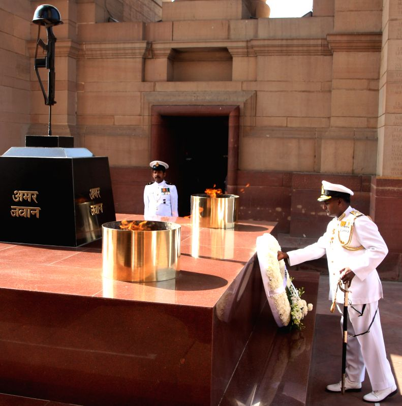 The Vice Admiral P. Murugesan lays wreath at Amar Jawan Jyoti, India Gate, in New Delhi on March 31, 2015.
