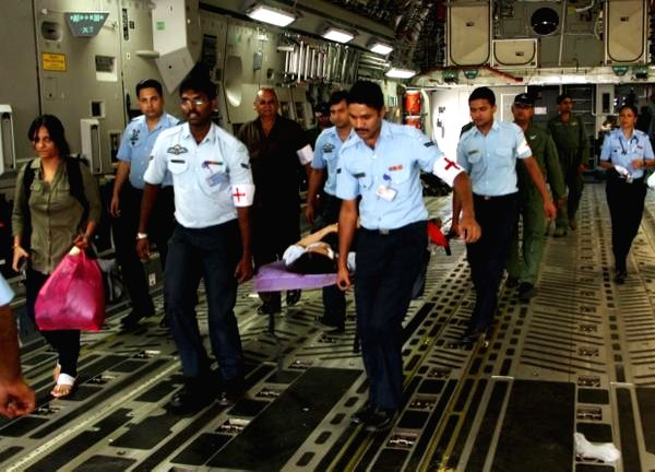The victims of Nepal earthquake being taken out of C-17 Globemaster III at Palam Airport,  in New Delhi, on April 28, 2015.