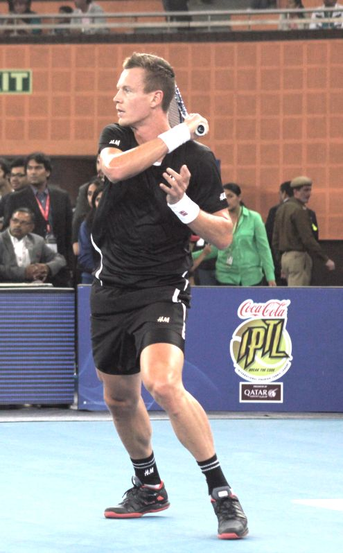 Tomas Berdych of Singapore Slammers in action during an IPTL men's singles match against Roger Federer of Indian Aces at Indira Gandhi Indoor Arena in New Delhi, on Dec 7, 2014. Federer ...