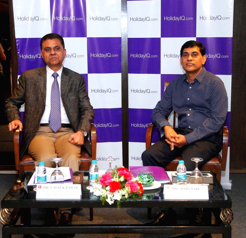 Tourism Secretary  Lalit K Panwar with founder and CEO of HolidayIQ Hari Nair at the launch of HolidayIQ's offline mobile guide in New Delhi.