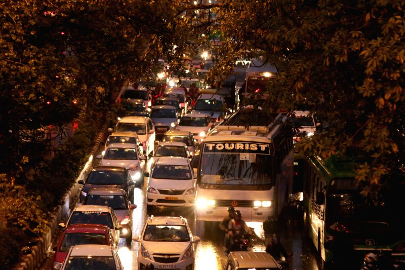 Traffic moves at a snail's speed after heavy rains lashed New Delhi, on March 7, 2015.